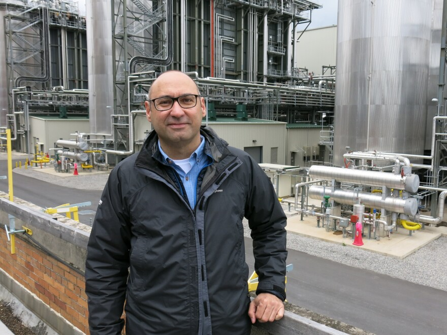 Joe Zokaites with redevelopment firm Arcova stands in front of a natural gas power plant built next to the old coal plant. The new facility takes up a fraction of the space and produces nearly three times the electricity.