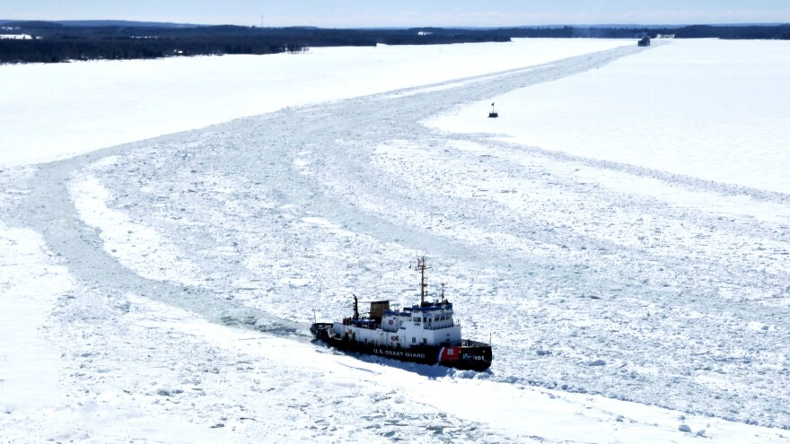 The U. S. Coast Guard Cutter Katmai Bay works in thick ice to break a path up St. Mary's River for the freighter Algoma Olympic. Heavy ice in the eastern end of Lake Superior and St. Mary's River has a fleet of icebreakers working to open shipping channels.