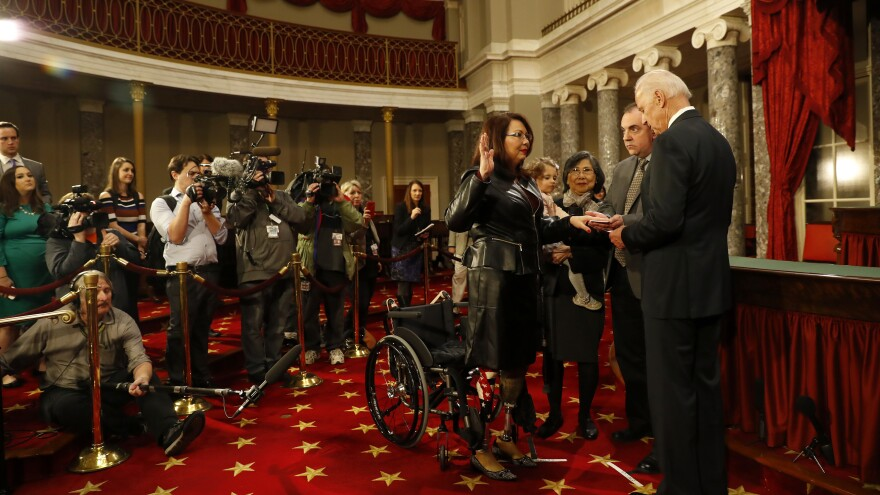 Then-Vice President Joe Biden participates in a reenacted Senate swearing-in with Duckworth in early 2017.