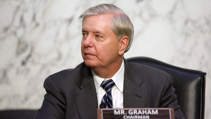 Sen. Lindsey Graham, R-S.C., looks on as Supreme Court nominee Judge Amy Coney Barrett testifies before the Senate Judiciary Committee on the third day of her confirmation hearing.