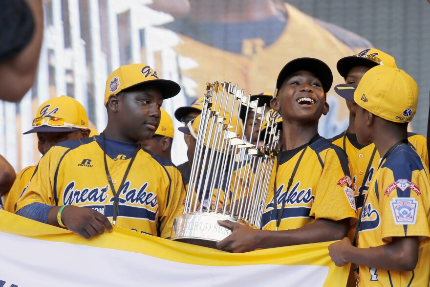 In this Aug. 27 photo, members of the Jackie Robinson West Little League baseball team participate in a rally in Chicago celebrating the team's U.S. Little League Championship. Little League International has stripped the team of its national title after finding the team falsified its boundary map.