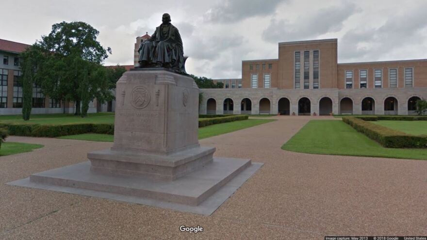 "Rice University says many undergraduate students from families with incomes up to $200,000 ""will no longer be required to take out loans."" Here, a statue of the school's founder, William Marsh Rice, is seen on its campus in Houston."