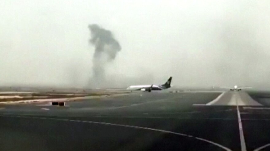 Smoke rises after an Emirates plane made an emergency landing at Dubai International Airport on Wednesday.