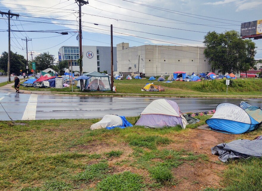 Since March, homeless residents have camped at 12th and College streets just east of uptown.