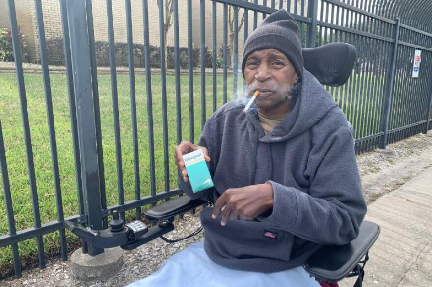 Veteran Ronald West sits in his wheelchair outside the Tampa VA smoking a cigarette.
