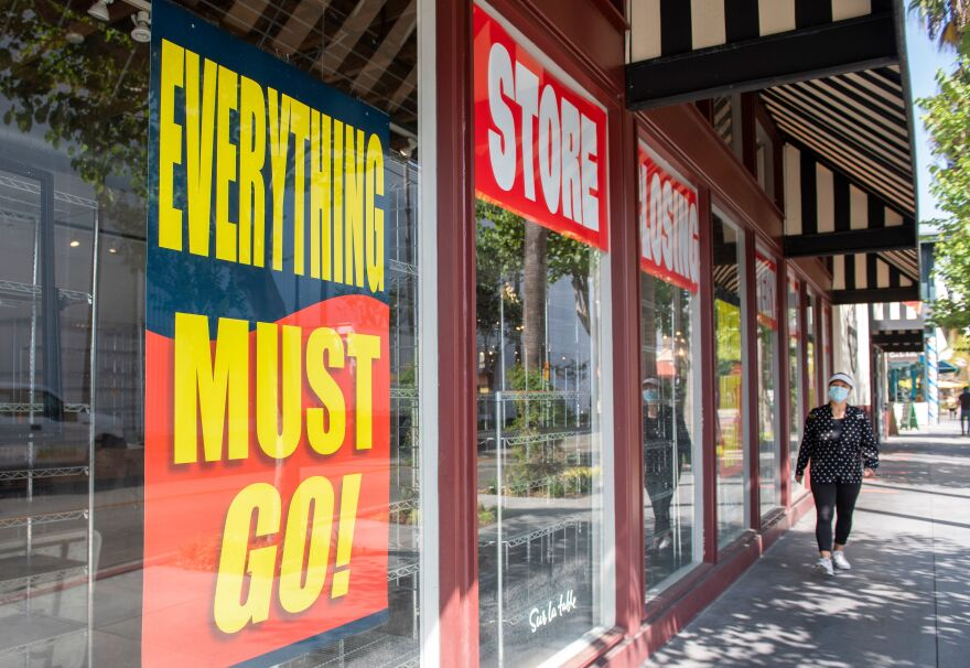 Store closing signs are posted at a Sur La Table kitchenware store on Sept. 22 in Los Angeles. Thousands of retail stores across the country have closed during the pandemic.