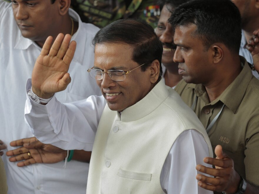 Sri Lankan President Maithripala Sirisena waves to supporters shortly after his election earlier this month. Sirisena looks to be trying to turn a new page in the island nation, which defeated a protracted insurgency in 2009.