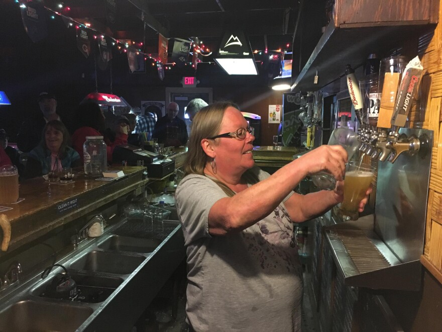 Without a high school degree, bartender Tammy Wood at first didn't know what she'd do without her job at Turner's.