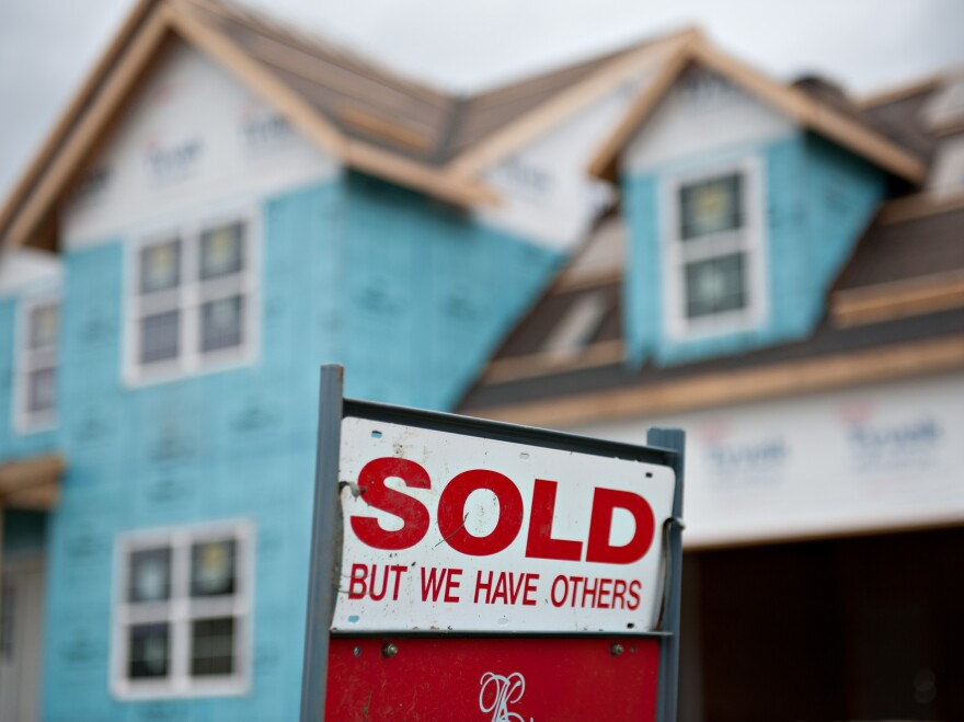 """A """"sold"""" sign outside a home under construction in Peoria, Ill., in October."""
