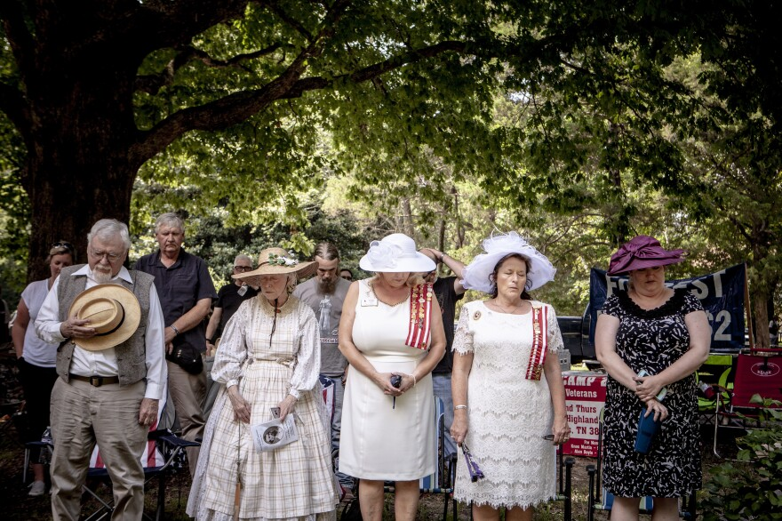 A moment of prayer is held during the celebration marking the 197th anniversary of Nathan Beford Forrest's birthday, in July at Davies Manor Plantation in Bartlett, Tenn.