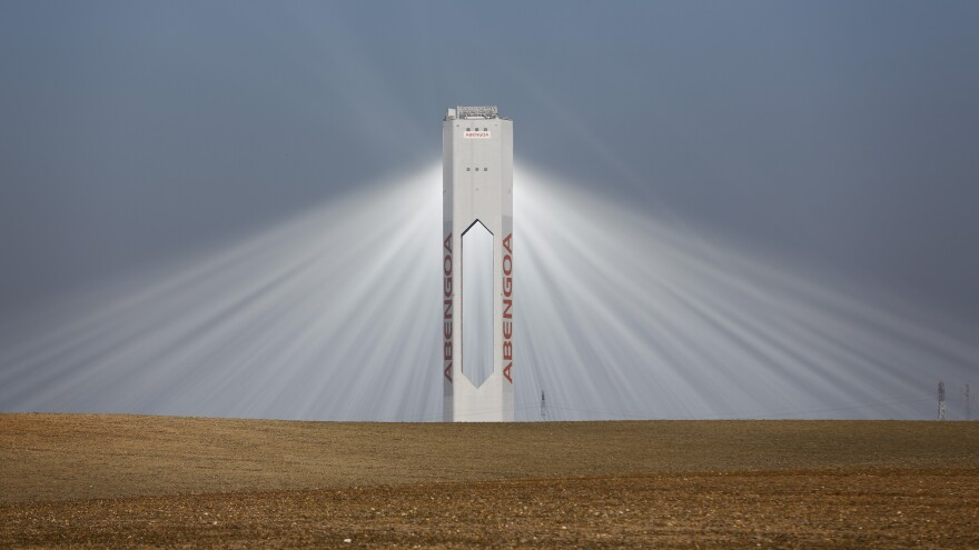 A solar tower belonging to the Spanish firm Abengoa is shown near Seville, in southern Spain, on Nov. 13. The large renewable energy company, which has been heavily subsidized by the government, is in danger of becoming the country's largest bankruptcy. The company also has a large solar facility in Arizona that has received U.S. government loan guarantees.