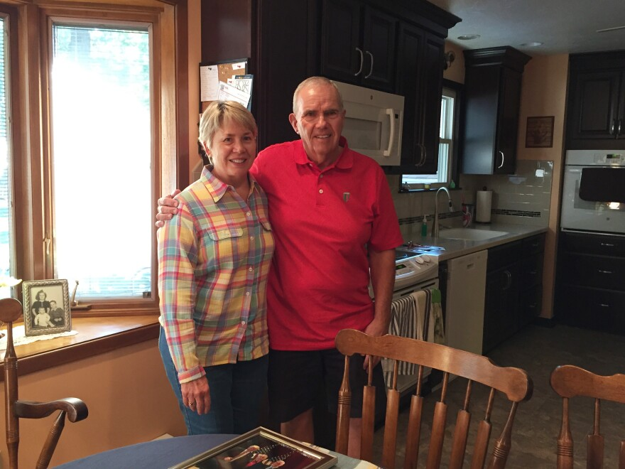 Retired plumber Marty Surella, with wife Karen, is a longtime Democrat who is leaning toward Trump, but remains undecided for now.