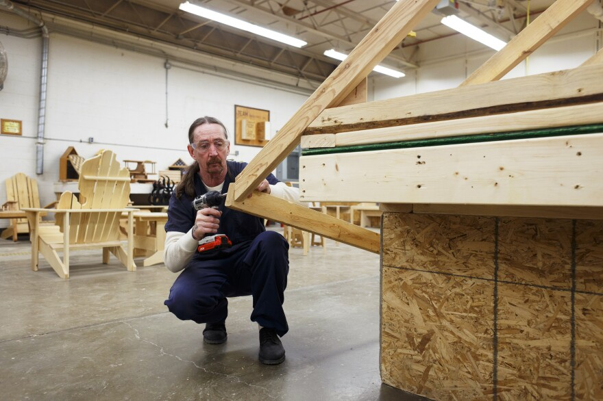 Garry Means, 51, helps disassemble part of a roof during the woodworking and carpentry portion of Vocational Village.
