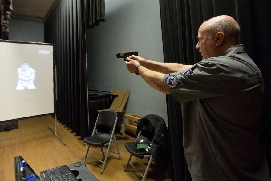 Ray Dunn, CEO of On the Mark Enhanced Tactical Training, teaches a gun training class for educators in Harrold ISD.