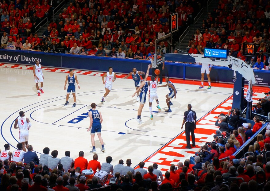 UD Arena was sold-out for the last game of the regular season on March 7, 2020, when the team won its 20th straight game. Here, Jalen Crutcher goes underneath the rim for a reverse layup during the Flyers victory.