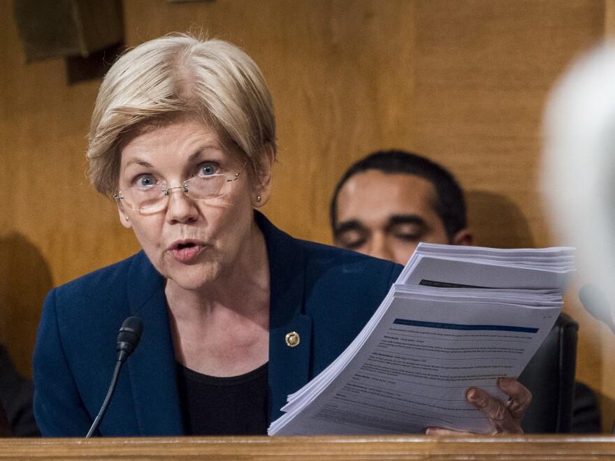 Sen. Elizabeth Warren questions John Stumpf, then CEO of Wells Fargo, during a Senate Banking Committee hearing on Sept. 20.