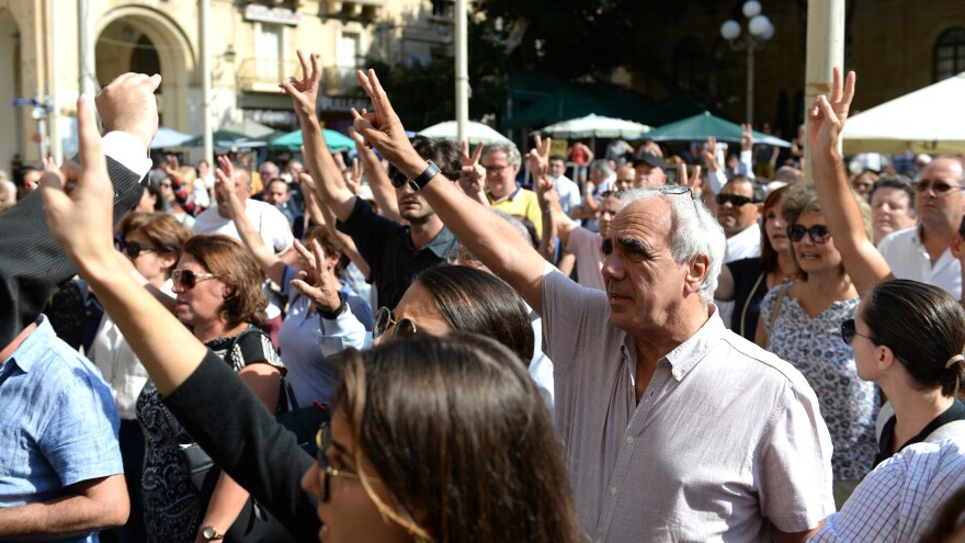 People gathered Tuesday outside the court in Valletta, Malta, demanding justice following the murder of Maltese journalist Daphne Caruana Galizia.