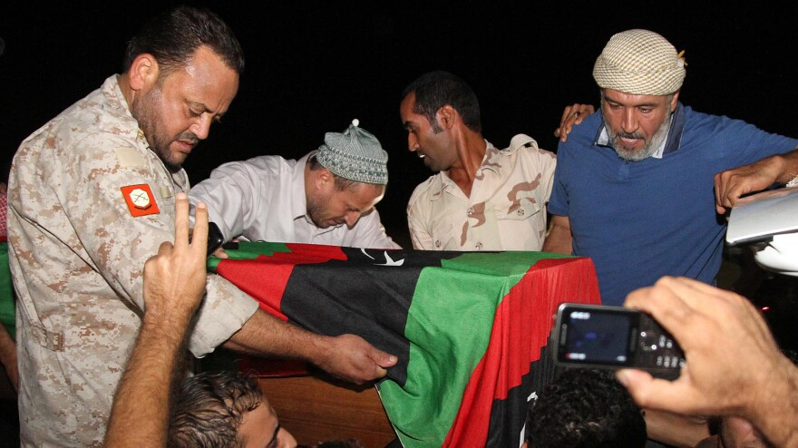 Friends and relatives of Omran Ben Shabaan carried his coffin Tuesday after it arrived as the airport in Misrata, Libya.