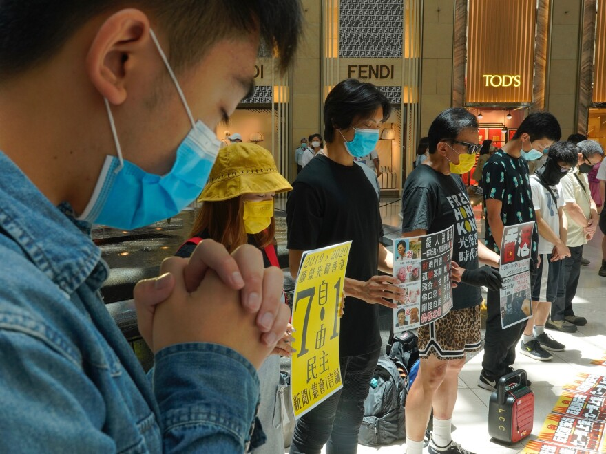 Protesters gather at a shopping mall in Hong Kong during a pro-democracy protest against Beijing's national security law on Tuesday.