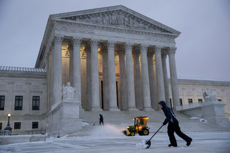 Workmen clear snow in front of the U.S. Supreme Court earlier this month.