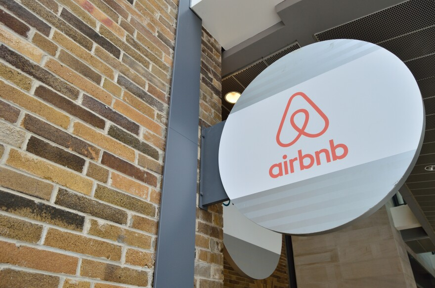 Photo of a sign that says airbnb on the outside of a building