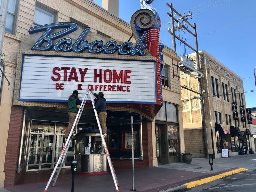 Employees at Billings' Babcock Theater swap signage on May 8, a day after the governor announced movie theaters, gyms and museums can reopen May 15.