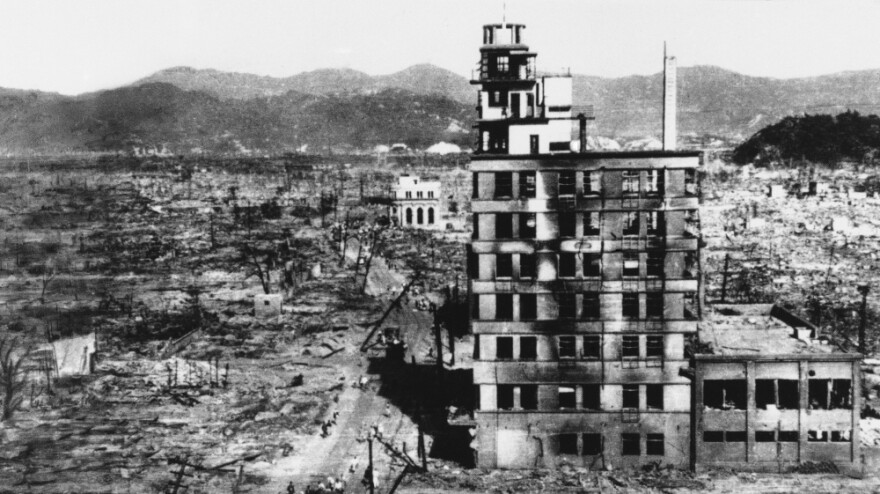 <p>Survivors walk past one of the few building still standing in 1945,  two days after an atomic bomb was dropped on Hiroshima, Japan on August 6, 1945.</p>