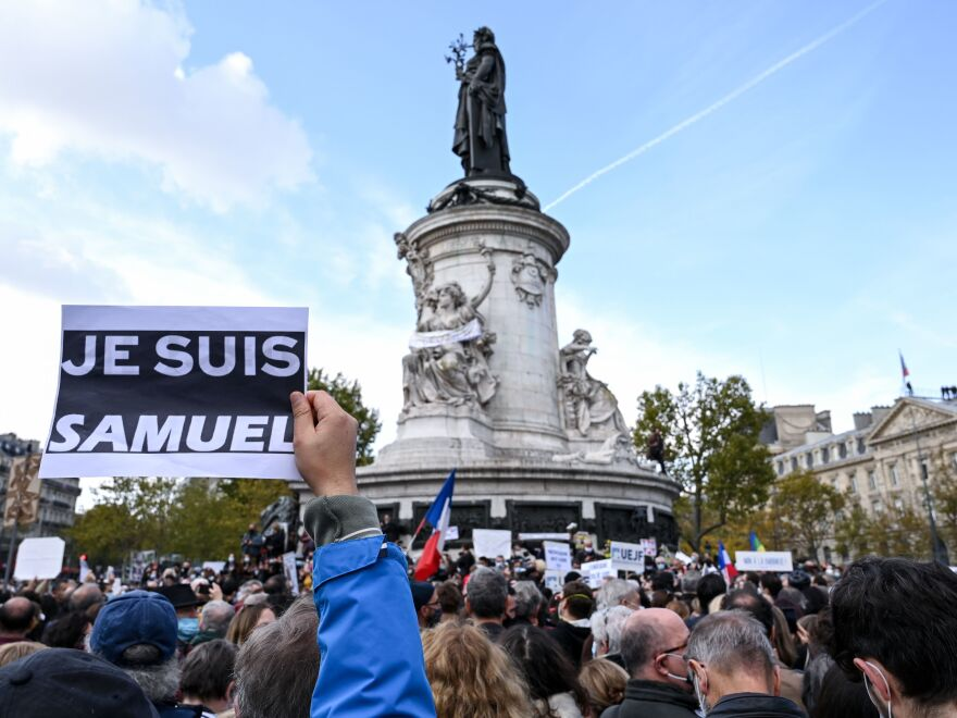 "Demonstrators like the one shown here carried ""I am Samuel"" signs as they gathered on Place de la République in Paris on Sunday to pay tribute to slain history teacher Samuel Paty. Similar gatherings took place in several other cities as France reels from the attack."