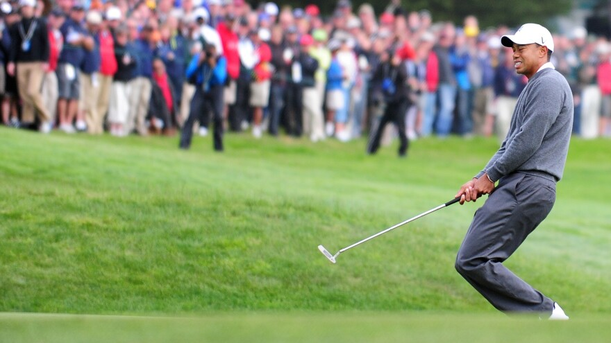 Tiger Woods reacts to a missed putt on the 13th hole on the first day of the US Open at San Francisco's Olympic Club.