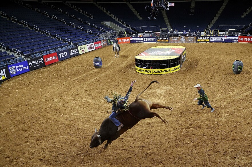 Dener Barbosa of Brazil rides a bull named Bullseye on his way to victory in the PBR Unleash The Beast Gwinnett Invitational on March 15 in Duluth, Ga. The public was not allowed to attend because of the worldwide spread of COVID-19.