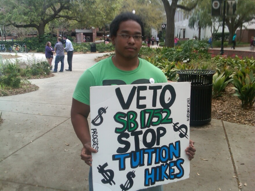 An FSU student protests against tuition hikes. Florida lawmakers recently stopped letting the state university system governing board approve tuition increases at public universities.