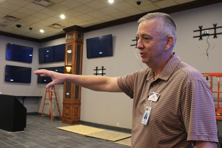David Monroe shows off the future sportsbook space at Lakeside Casino. By opening day more big screens will be installed and the casino will be ready to take bets.