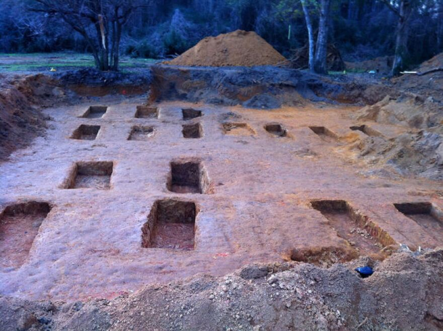The empty burial sites after the team excavated 51 individual sets of remains from 55 graveshafts on the Dozier campus in August-September 2013.