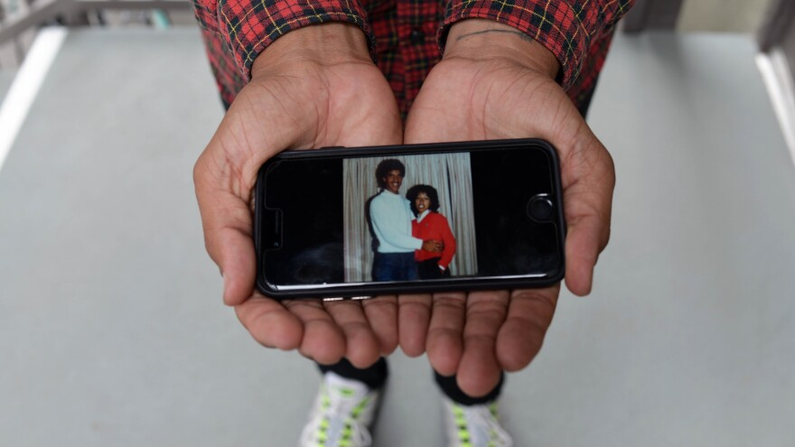 """Walter Thompson-Hernandez displays a photograph of his parents, Kerry Thompson and Ellie Hernandez. Thompson-Hernandez identifies as a """"blaxican"""" — another term for Afro-Mexican, the identity soon to be included on the Mexican census for the first time."""