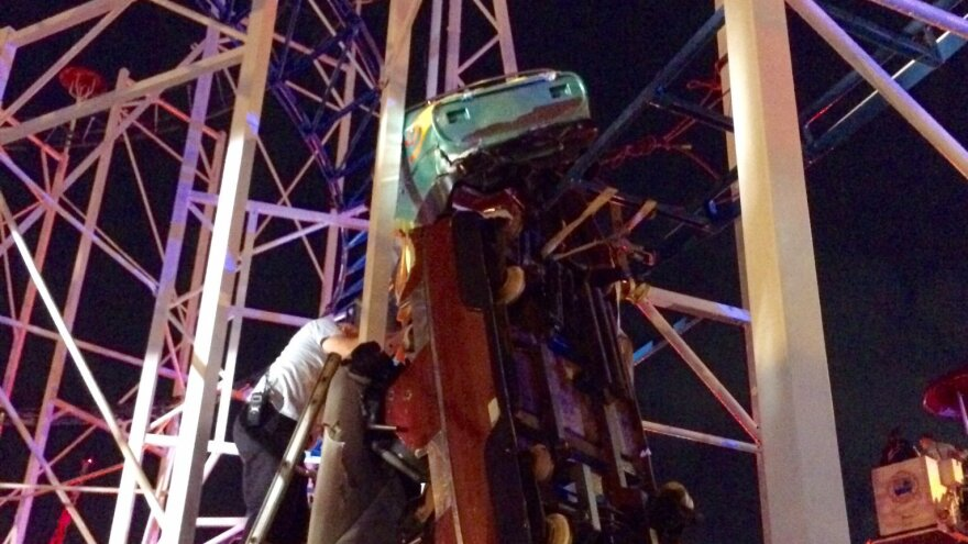 """Firefighters working as fast as they can to rescue 2 riders that are in a dangling rollercoaster car,"" the Daytona Beach Fire Department tweeted late Thursday."