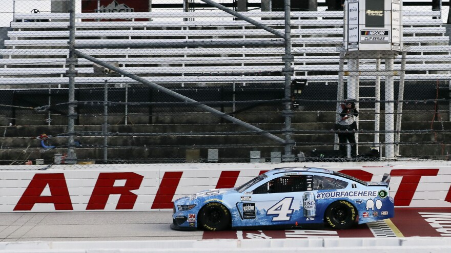 Kevin Harvick crosses the finish line to win the NASCAR Cup Series auto race Sunday in Darlington, S.C. It's the first NASCAR race since March.