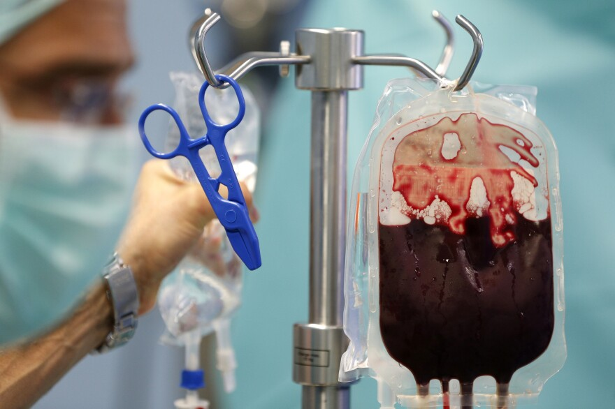 A blood transfusion bag hangs in an operating room in a hospital in the Republic of Congo. Most countries in sub-Saharan Africa have a huge gap between blood supply and demand, new research found.
