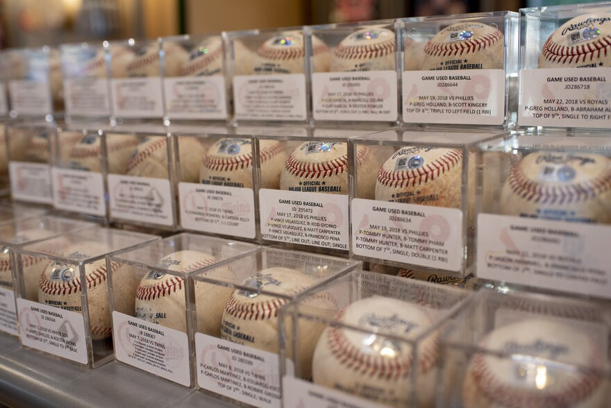 The Authentics Shop at Busch Stadium displays authenticated game balls for sale. Aug. 16, 2018
