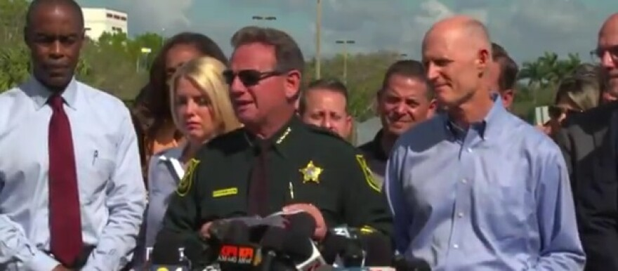 Former Gov. Rick Scott with now suspended Broward Sheriff Scott Israel and Supt. Rob Runcie at a 2018 press conference following the shooting at Marjory Stoneman Douglas High School in Parkland, FL.