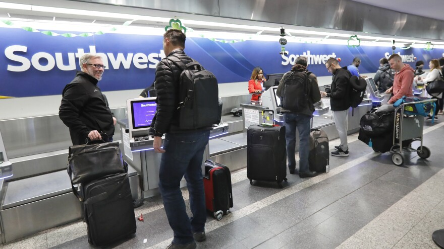 Southwest Airlines passengers check in at New York's LaGuardia Airport. The Federal Aviation Administration on Wednesday issued an emergency order grounding Boeing 737 Max jets in the wake of the crash of an Ethiopian airliner.