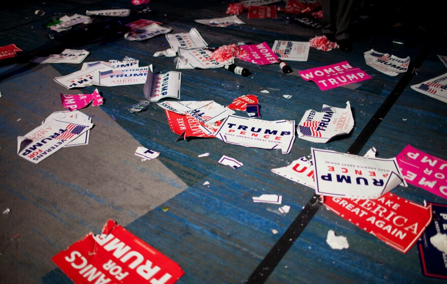 Placards and beer bottles litter the floor of the ballroom where Trump spoke on election night after defeating Clinton.