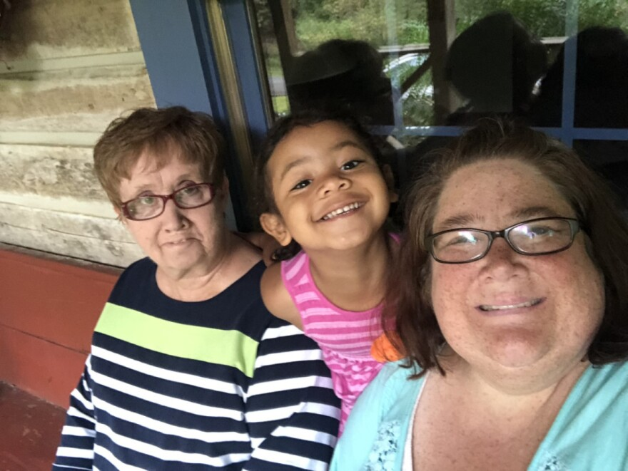 Maxine Edwards takes care of granddaughter Kinsley because preschool is closed due to the coronavirus pandemic. Kinsley's mom, Kristi Edwards, continues working as a patient coordinator at a hearing center.