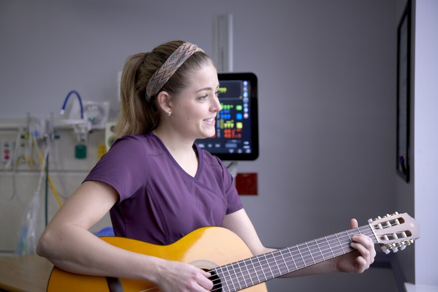 FSU alumna Ciele Gutierrez offers music therapy to a baby in the NICU at Tallahassee Memorial Hospital.