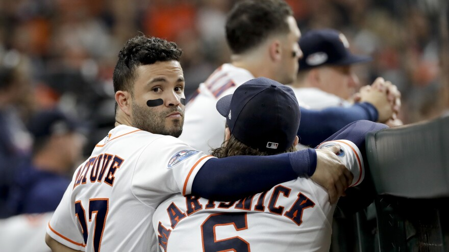 The Houston Astros' Jose Altuve and Jake Marisnick watch from the dugout on Thursday. Houston won the 2017 World Series but fell just short this season.