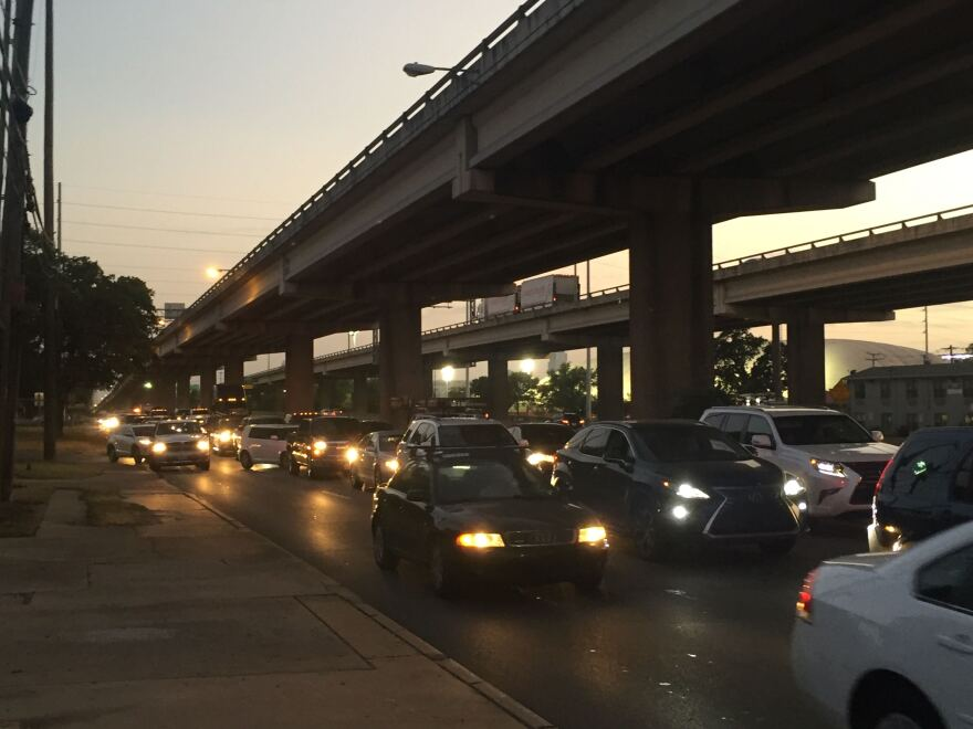 """Traffic is diverted onto the northbound I-35 access road after """"large pieces"""" of the upper deck fell onto the lower deck Tuesday night."""