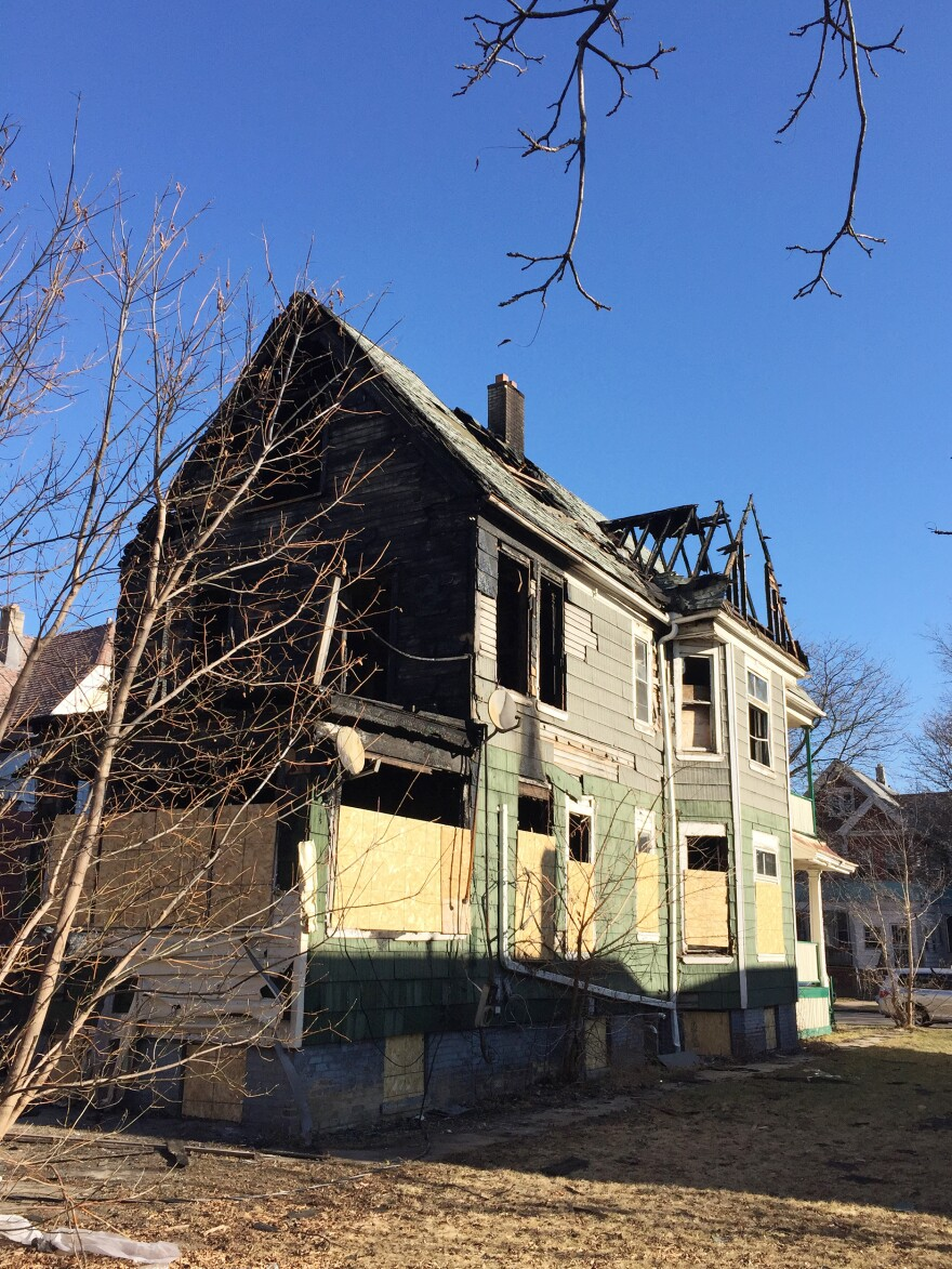 Some abandoned homes have been burned out and are waiting to be torn down.