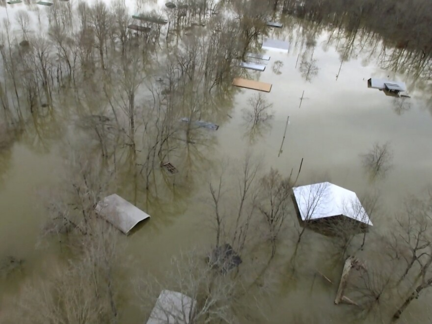 Buildings were underwater on Saturday in Savannah, Tenn., after days of heavy rain in the area.