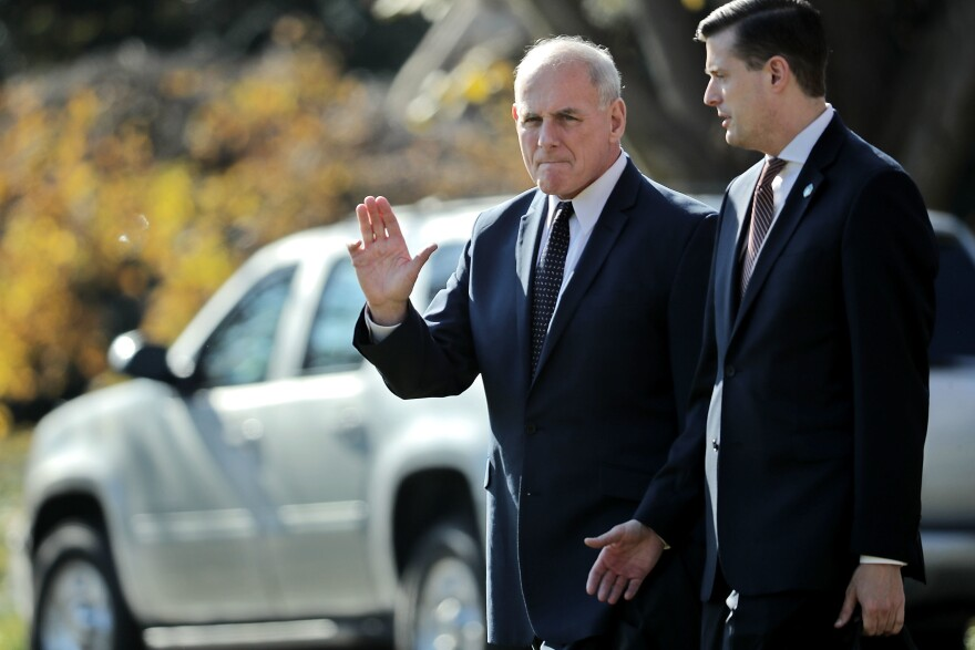 White House chief of staff John Kelly (left) and then-staff secretary Rob Porter leave the White House with President Trump last November. Porter, who had been working for months under an interim security clearance, was forced to resign in February after allegations of domestic abuse became public.