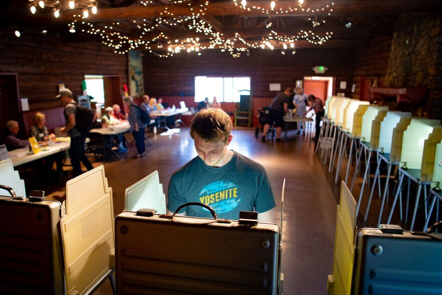 Voters fill out their ballots for the presidential primary in a log cabin run by the American Legion in San Anselmo, Calif., on Super Tuesday. While no significant foreign interference was detected, election and law enforcement officials are closely monitoring this year's primaries.