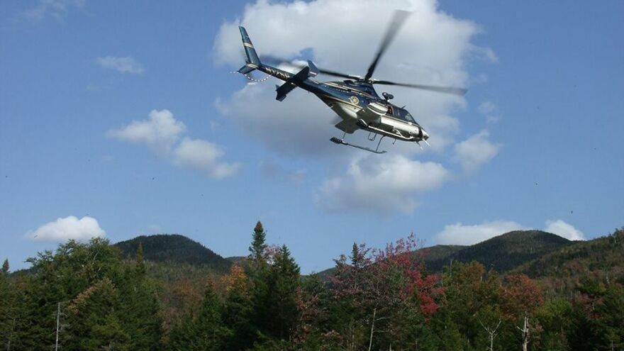 A New York state police helicopter lifts off from a stream valley below Indian Pass, shuttling forest rangers and their equipment in and out of the wilderness.